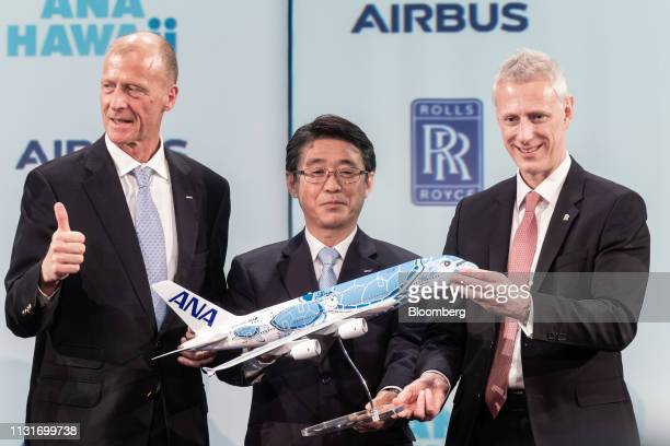 Shinya Katanozaka chief executive officer of ANA Holdings Inc center Tom Enders chief executive officer of Airbus SE left and Chris Cholerton chief...