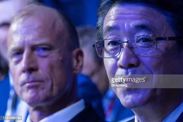 Shinya Katanozaka chief executive officer of ANA Holdings Inc sits in the audience with Tom Enders chief executive officer of Airbus SE during a...