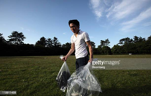 Shinya Sato who evacuated from Namie town carries his belongings after a brief visit to his home in the 20kilometer exclusion zone around Tokyo...