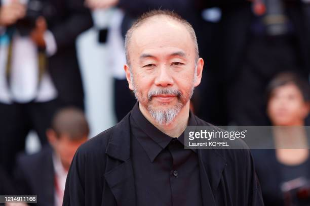 Shinya Tsukamoto walks the red carpet ahead of the closing ceremony of the 76th Venice Film Festival at Sala Grande on September 07 2019 in Venice...