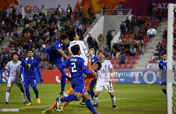 Shinya Yajima of Japan scores his team's second goal during the AFC U23 Championship Group B match between Thailand and Japan at Grand Hamad Stadium...