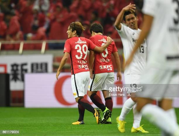 Shinya Yajima of Urawa Red Diamonds celebtrates scoring his side's first goal with Tomoya Ugajin of Urawa Red Diamonds during the JLeague J1 match...