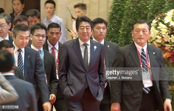 Shinz Abe Prime Minister of Japan walks to a meeting during the Association of Southeast Asian Nations summit the Laotian capital Vientiane