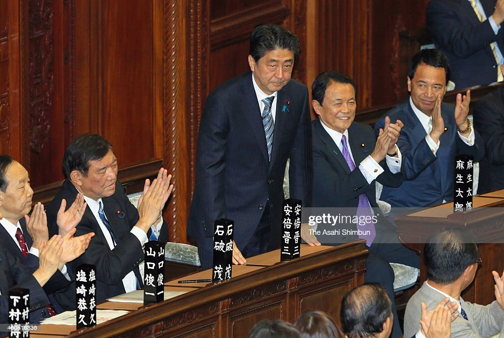 Shinzo Abe (C) acknowledges Lower House members after being re-elected as Japanese Prime Minister at the lower house plenary session of the Diet on December 24, 2014 in Tokyo, Japan. Easily re-elected Prime Minister Shinzo Abe named Gen Nakatani to replace scandal-tainted Akinori Eto as defense minister, the only change in the Cabinet following the ruling party's Lower House election victory on December 14. The special Diet session will close on Dec. 26 because its main business is to formally choose the prime minister.