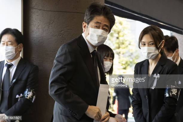 Shinzo Abe, former prime minister of Japan, arrives for the memorial ceremony marking the 10-year Anniversary of the Great East Japan Earthquake at...