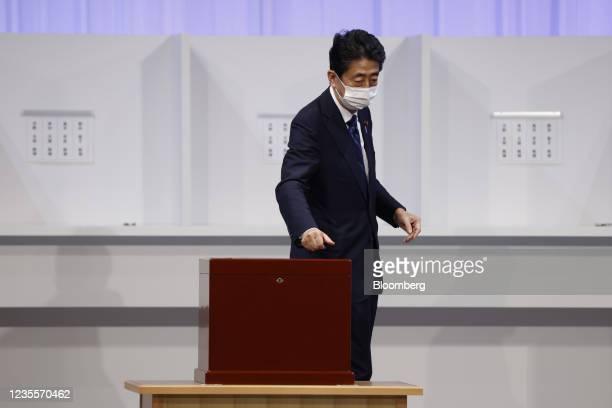 Shinzo Abe, former prime minister of Japan, casts his ballot at the Liberal Democratic Party's leadership election in Tokyo, Japan, on Wednesday,...