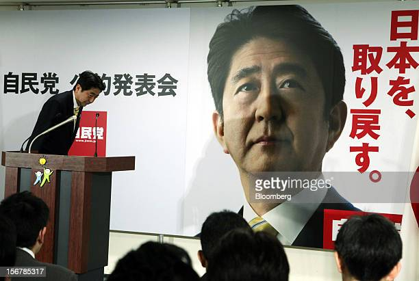 Shinzo Abe Japan's former prime minister and president of the Liberal Democratic Party arrives for a news conference in Tokyo Japan on Wednesday Nov...