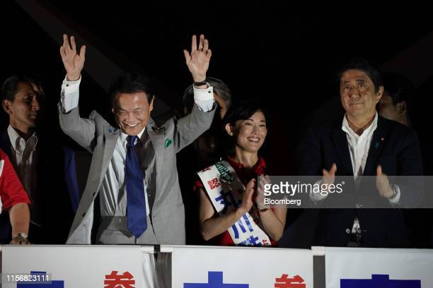 Shinzo Abe, Japan's prime minister and president of the Liberal Democratic Party , right, and Taro Aso, Japan's deputy prime minister and finance...