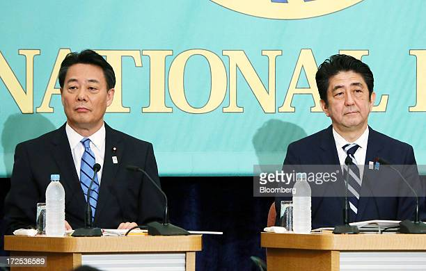 Shinzo Abe Japan's prime minister and president of the Liberal Democratic Party right and Banri Kaieda president of the Democratic Party of Japan...