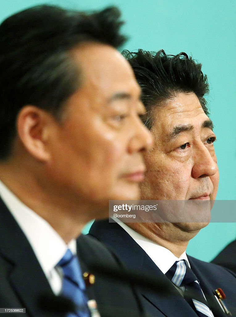 Shinzo Abe, Japan's prime minister and president of the Liberal Democratic Party (LDP), right, and Banri Kaieda, president of the Democratic Party of Japan (DPJ), attend a debate at the Japan National Press Club in Tokyo, Japan, on Wednesday, July 3, 2013. Abe called for laws, not force-based order, in the Asia region during a televised debate with leaders of other political parties in Tokyo today ahead of the July 21 upper house election. Photographer: Haruyoshi Yamaguchi/Bloomberg via Getty Images