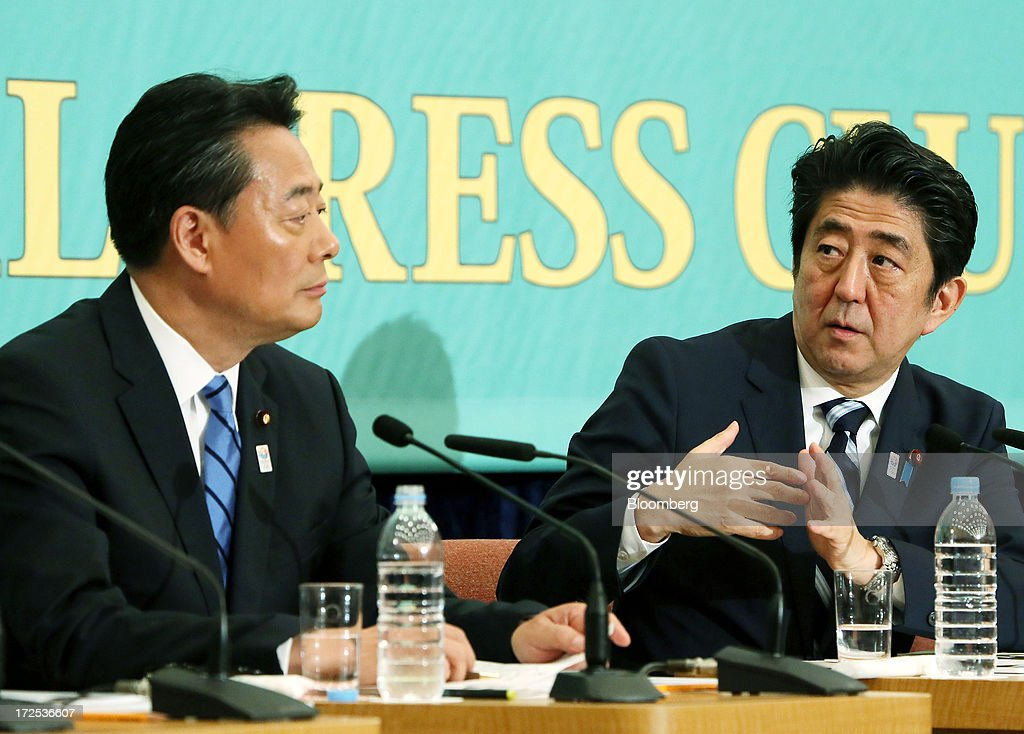 Shinzo Abe, Japan's prime minister and president of the Liberal Democratic Party (LDP), right, speaks as he responds to Banri Kaieda, president of the Democratic Party of Japan (DPJ), during a debate at the Japan National Press Club in Tokyo, Japan, on Wednesday, July 3, 2013. Abe called for laws, not force-based order, in the Asia region during a televised debate with leaders of other political parties in Tokyo today ahead of the July 21 upper house election. Photographer: Haruyoshi Yamaguchi/Bloomberg via Getty Images