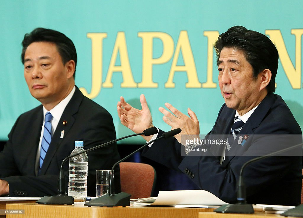Shinzo Abe, Japan's prime minister and president of the Liberal Democratic Party (LDP), right, speaks as Banri Kaieda, president of the Democratic Party of Japan (DPJ), looks on during a debate at the Japan National Press Club in Tokyo, Japan, on Wednesday, July 3, 2013. Abe called for laws, not force-based order, in the Asia region during a televised debate with leaders of other political parties in Tokyo today ahead of the July 21 upper house election. Photographer: Haruyoshi Yamaguchi/Bloomberg via Getty Images