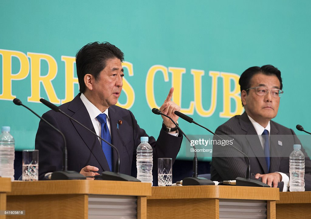 Shinzo Abe, Japan's prime minister and president of the Liberal Democratic Party (LDP), left, speaks as Katsuya Okada, president of the Democratic Party, looks on during their debate ahead of the upper house election at the Japan National Press Club in Tokyo, Japan, on Tuesday, June 21, 2016. It is for Bank of Japan to decide what monetary policy methods to use, said Abe during the debate. Photographer: Tomohiro Ohsumi/Bloomberg via Getty Images