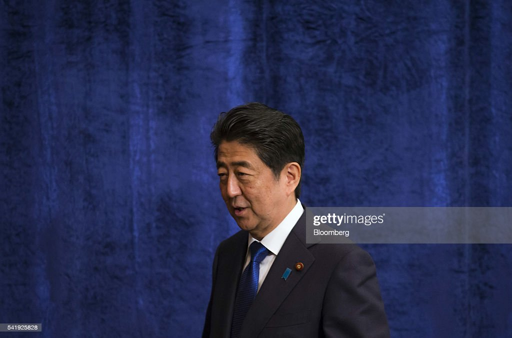 Shinzo Abe, Japan's prime minister and president of the Liberal Democratic Party (LDP), leaves a debate with other party leaders ahead of the upper house election at the Japan National Press Club in Tokyo, Japan, on Tuesday, June 21, 2016. It is for Bank of Japan to decide what monetary policy methods to use, said Abe during the debate. Photographer: Tomohiro Ohsumi/Bloomberg via Getty Images