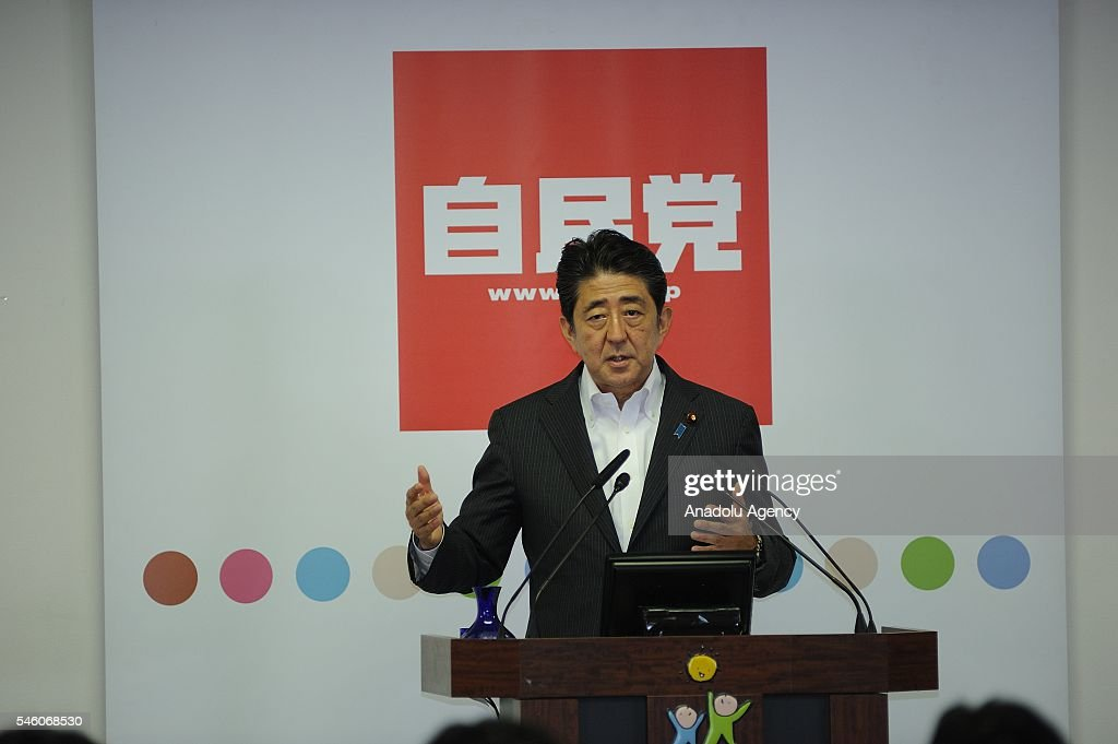 Shinzo Abe, Japan's Prime Minister and President of the Liberal Democratic Party (LDP) gestures during a press conference after the ruling coalition of the LDP and Komeito won a majority of the contested seats in the Upper House Election at the head quarter of LDP in Tokyo, Japan on July 11, 2016.