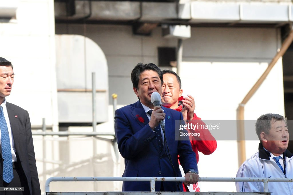 Shinzo Abe, Japans prime minister and president of the Liberal Democratic Party (LDP), center, speaks during an election campaign rally in Sapporo, Hokkaido, on Sunday, Oct. 15, 2017. Abe looked set to retain his coalitions dominant position in parliament after the Oct. 22 general election, according to a series of large opinion surveys carried out by domestic media. Photographer: Eiji Ohashi/Bloomberg via Getty Images
