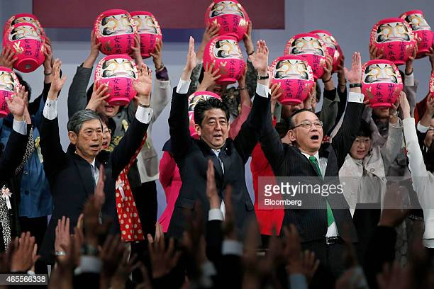 Shinzo Abe Japan's prime minister and president of the ruling Liberal Democratic Party front center Sadakazu Tanigaki secretary general front right...