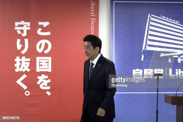 Shinzo Abe Japan's prime minister and president of the ruling Liberal Democratic Party leaves a news conference at the party's headquarters in Tokyo...