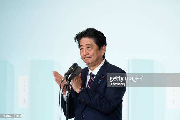 Shinzo Abe Japan's prime minister applauds before delivering a speech after winning the Liberal Democratic Party's presidential election at its...