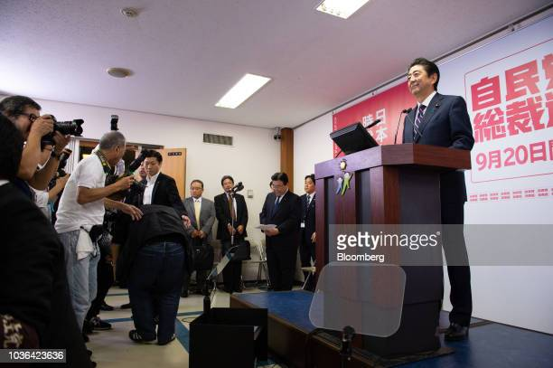 Shinzo Abe Japan's prime minister arrives for a news conference at the Liberal Democratic Party's headquarters in Tokyo Japan on Thursday Sept 20...