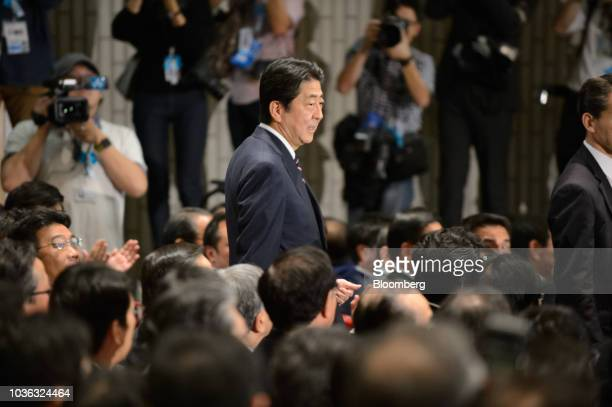 Shinzo Abe Japan's prime minister arrives for the Liberal Democratic Party's presidential election at its headquarters in Tokyo Japan on Thursday...