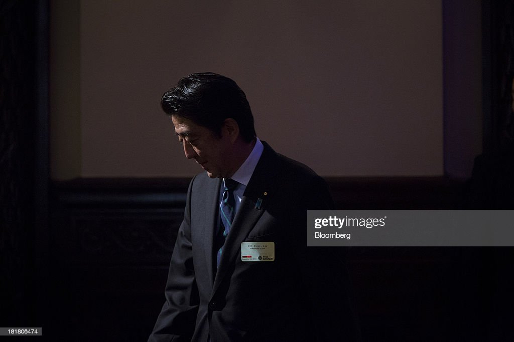Shinzo Abe, Japan's prime minister, arrives to deliver a speech at the New York Stock Exchange (NYSE) in New York, U.S., on Wednesday, Sept. 25, 2013. Abe's pledge to end 15 years of deflation and the Bank of Japan's monetary policy easing, along with Tokyo's winning bid to host the 2020 Olympic Games have helped boost consumer sentiment. Photographer: Scott Eells/Bloomberg via Getty Images