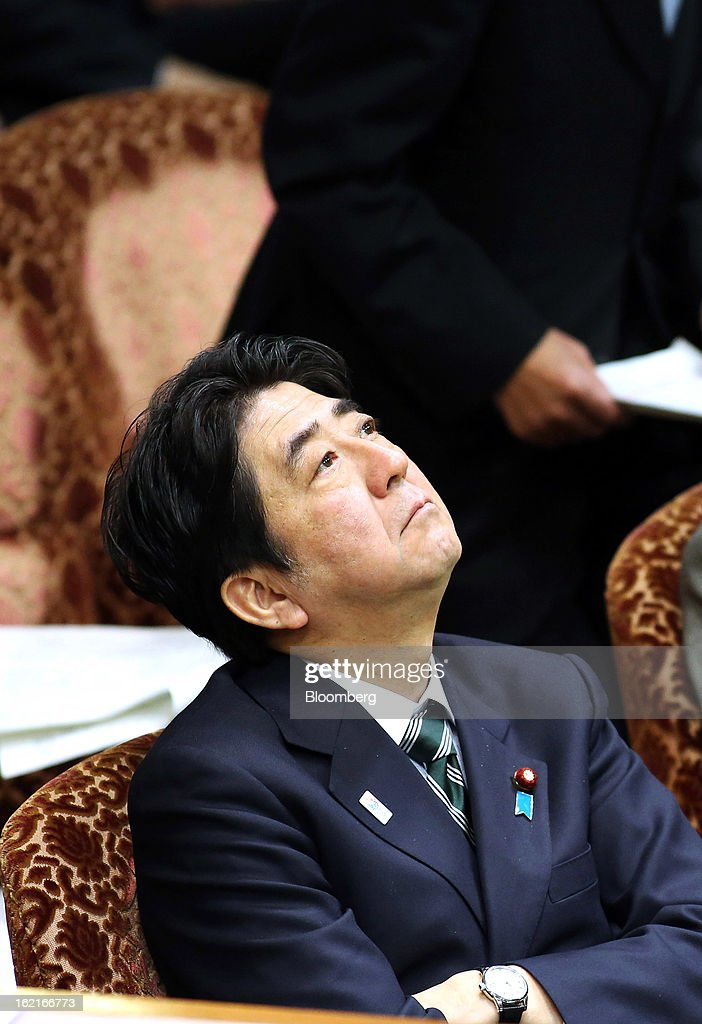 Shinzo Abe, Japan's prime minister, attends a budget committee session at the upper house of parliament in Tokyo, Japan, on Wednesday, Feb. 20, 2013. Abe said that the need to buy foreign bonds has decreased, backing away from a policy proposal that may be seen by other nations as a direct attempt to weaken the yen. Photographer: Haruyoshi Yamaguchi/Bloomberg via Getty Images