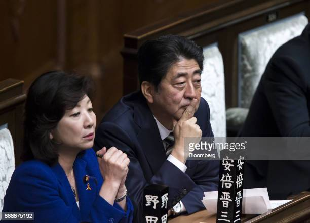 Shinzo Abe Japan's prime minister center and Seiko Noda Japan's internal affairs and communications minister left attend a plenary session at the...