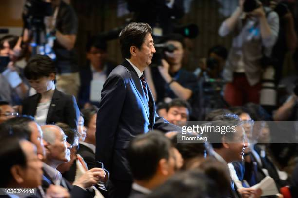 Shinzo Abe Japan's prime minister center arrives for the Liberal Democratic Party's presidential election at its headquarters in Tokyo Japan on...