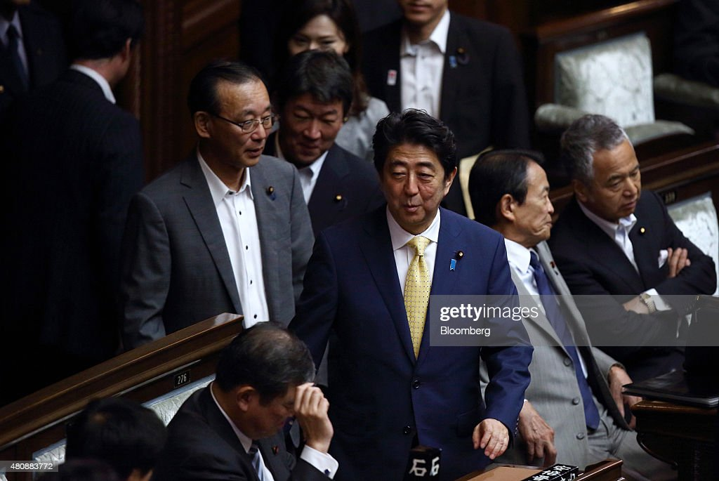 Shinzo Abe, Japan's prime minister, center, attends a plenary session at the lower house of the parliament in Tokyo, Japan, on Thursday, July 16, 2015. Abe's security bills passed parliament's lower house Thursday after a night of noisy protests, as his push to expand the role of the military risks further eroding his public support. Photographer: Tomohiro Ohsumi/Bloomberg via Getty Images