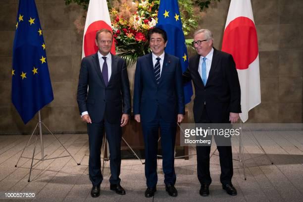 Shinzo Abe Japan's prime minister center Donald Tusk president of the European Union left and JeanClaude Juncker president of the European Commission...