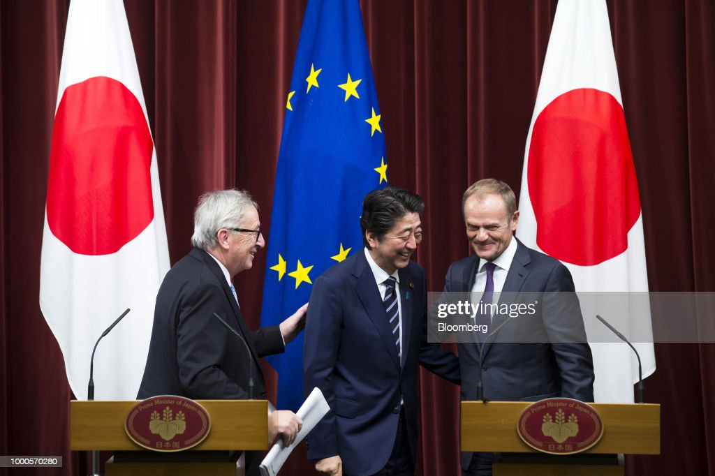 Shinzo Abe, Japan's prime minister, center, Jean-Claude Juncker, president of the European Commission, left, and Donald Tusk, president of the European Union (EU), leave a joint news conference following a summit at the prime minister's official residence in Tokyo, Japan, on Tuesday, July 17, 2018. Japan and the EU signed a trade agreement on Tuesday in Tokyo that lowers barriers on the movement of goods and services between the two economies and provides a counterweight to U.S. protectionism. Photographer: Tomohiro Ohsumi/Bloomberg via Getty Images