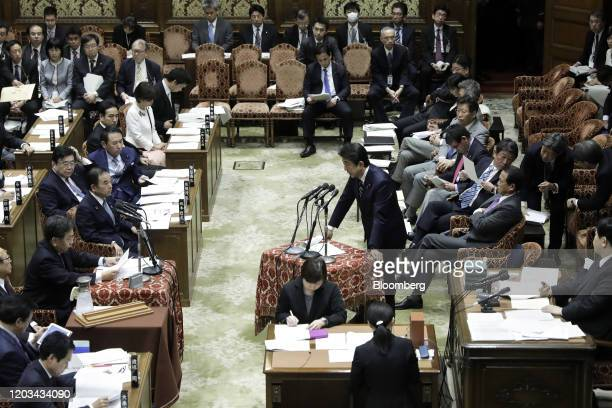 Shinzo Abe, Japan's prime minister, center, speaks during a budget committee session at the lower house of parliament in Tokyo, Japan, on Wednesday,...