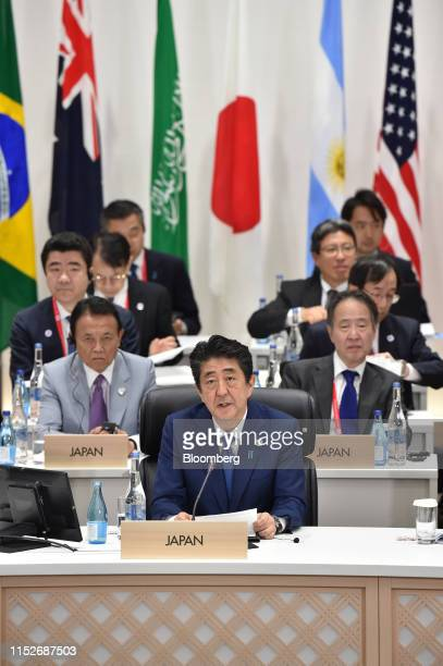 Shinzo Abe, Japan's prime minister, center, speaks during a session at the Group of 20 summit in Osaka, Japan, on Saturday, June 29, 2019. Disputes...
