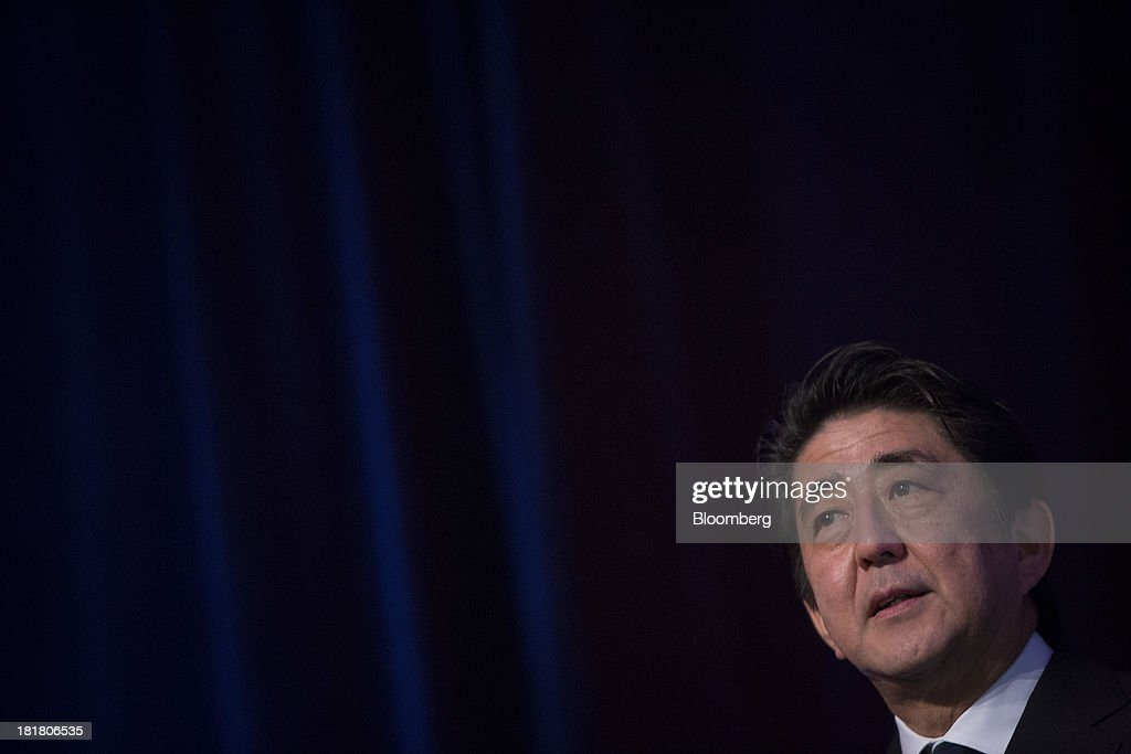 Shinzo Abe, Japan's prime minister, delivers a speech at the New York Stock Exchange (NYSE) in New York, U.S., on Wednesday, Sept. 25, 2013. Abe's pledge to end 15 years of deflation and the Bank of Japan's monetary policy easing, along with Tokyo's winning bid to host the 2020 Olympic Games have helped boost consumer sentiment. Photographer: Scott Eells/Bloomberg via Getty Images