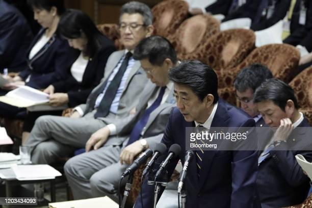 Shinzo Abe, Japan's prime minister, foreground, speaks during a budget committee session at the lower house of parliament in Tokyo, Japan, on...