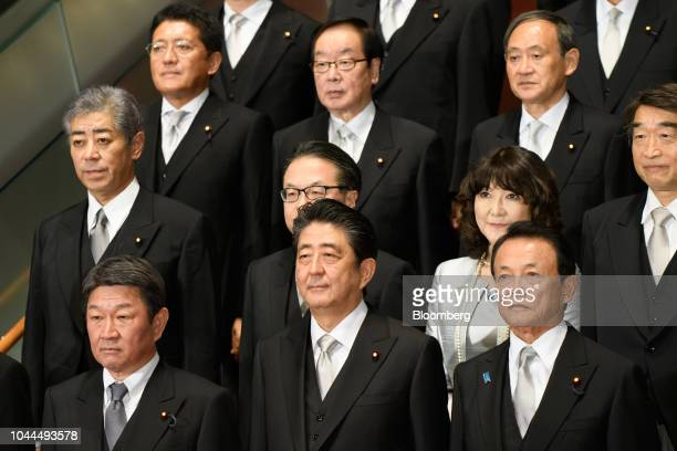 Shinzo Abe Japan's prime minister front row center poses for a group photograph with his new cabinet members including Taro Aso deputy prime minister...