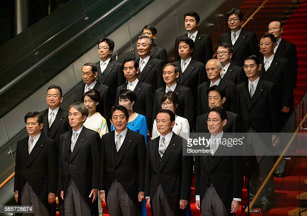 Shinzo Abe Japan's prime minister front row center poses for a group photograph with members of his new cabinet at the prime minister's official...