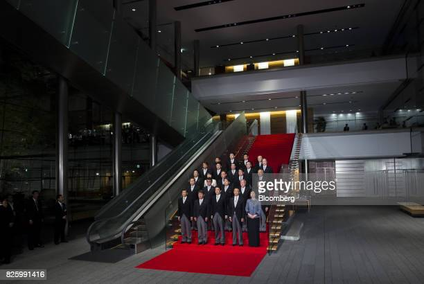 Shinzo Abe Japan's prime minister front row center poses for a group photograph with his new cabinet members at the Prime Minister's official...