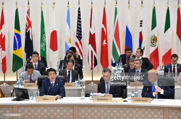 Shinzo Abe, Japan's prime minister, front row left, speaks as Mauricio Macri, Argentina's president, front row center, and U.S. President Donald...