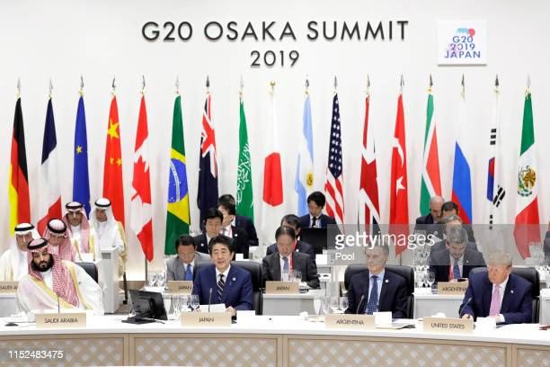 Shinzo Abe Japan's prime minister front row second left speaks while Mohammed Bin Salman Saudi Arabia's crown prince and deputy prime minister front...