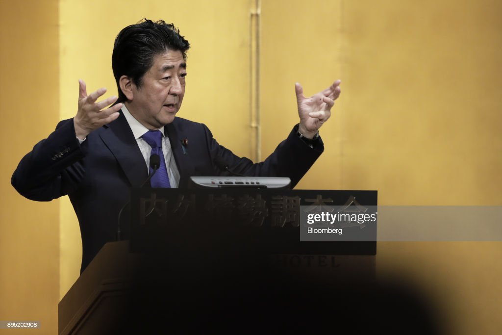 Shinzo Abe, Japan's prime minister, gestures as he speaks at an event hosted by the Research Institute of Japan in Tokyo, Japan, on Tuesday, Dec. 19, 2017. Abe said he wants take ties with China to a new level. Photographer: Kiyoshi Ota/Bloomberg via Getty Images