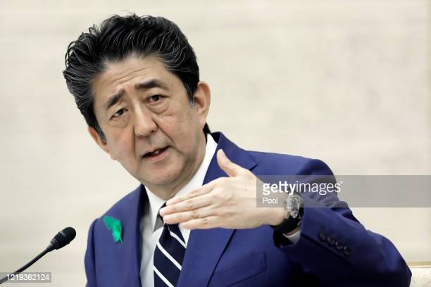 Shinzo Abe Japan's prime minister gestures as he speaks during a news conference at the prime minister's official residence on April 17 2020 in Tokyo...