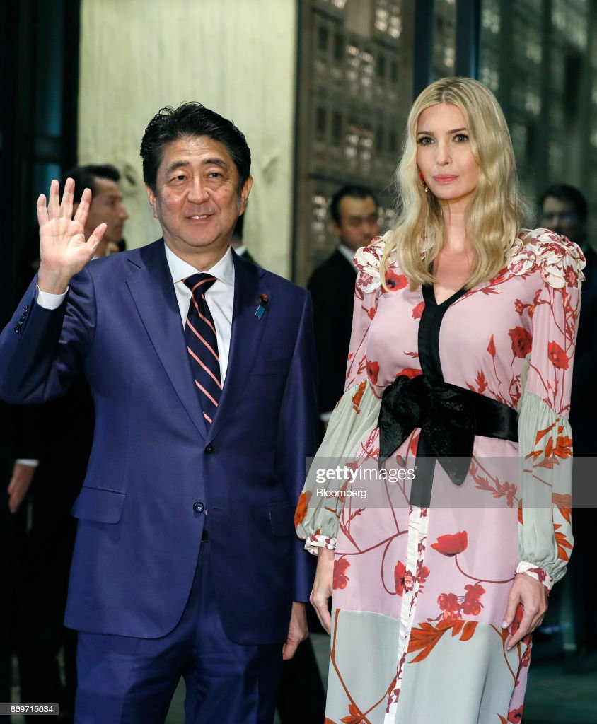 Shinzo Abe, Japan's prime minister, left, and Ivanka Trump, assistant to U.S. President Donald Trump, pose for photographers as they arrive for a dinner in Tokyo, Japan, on Friday, Nov. 3, 2017. Ivanka Trump lauded the Japanese governments efforts to increase female workforce participation during a speech in Tokyo on Friday, giving a high-profile boost to Prime Minister Shinzo Abe's 'Womenomics' initiative. Photographer: Kimimasa Mayama/Pool via Bloomberg