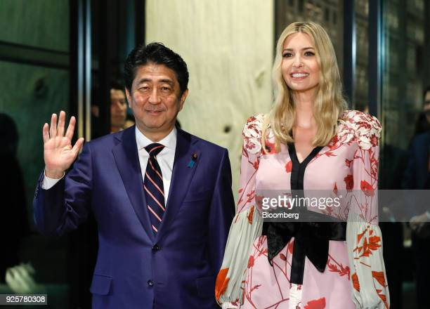Shinzo Abe Japan's prime minister left and Ivanka Trump assistant to US President Donald Trump pose for photographers as they arrive for a dinner in...