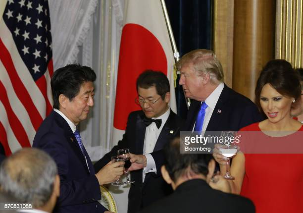 Shinzo Abe Japan's prime minister left toasts with US President Donald Trump as US First Lady Melania Trump raises a glass during a state banquet at...