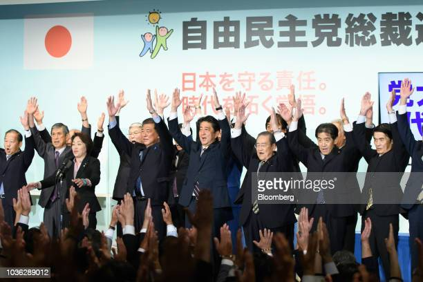 Shinzo Abe Japan's prime minister middle cheers with Liberal Democratic Party members after he was elected the party's president at the party's...