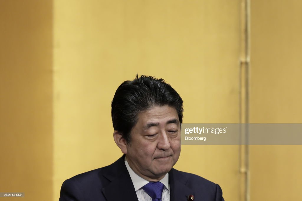 Shinzo Abe, Japan's prime minister, pauses while speaking at an event hosted by the Research Institute of Japan in Tokyo, Japan, on Tuesday, Dec. 19, 2017. Abe said he wants take ties with China to a new level. Photographer: Kiyoshi Ota/Bloomberg via Getty Images