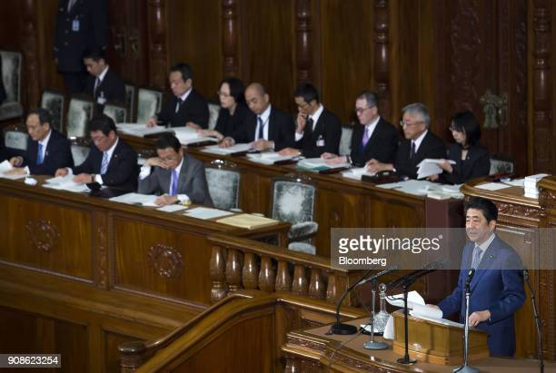 Shinzo Abe Japan's prime minister right delivers his policy speech during a plenary session at the lower house of parliament in Tokyo Japan on Monday...