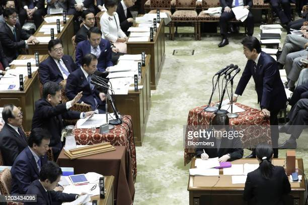 Shinzo Abe, Japan's prime minister, right, speaks while Yukio Edano, head of the Constitutional Democratic Party of Japan, gestures during a budget...